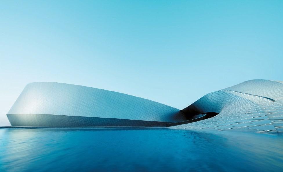 Wie ein gigantischer Wasserwirbel schraubt sich das neue Gebäude aus der Uferebene des Öresunds