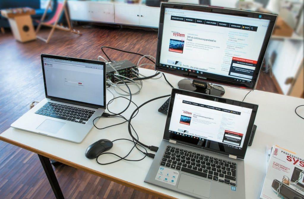 Als Signalquellen sind ein Mac-Rechner und ein Windows-Laptop (aktive Quelle) jeweils über den HDMI-Eingang des zugehörigen TRX angeschlossen. Am HDMI-Ausgang des dritten TRX hängt ein PC-Monitor als Ausgabegerät.